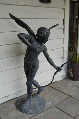 Lead Figure of Eros with Bow, Greek God of Love. Crafted copper bow. Solid Lead. £1,250. Buy online or visit Debden Barns Antiques Saffron Walden, Essex.