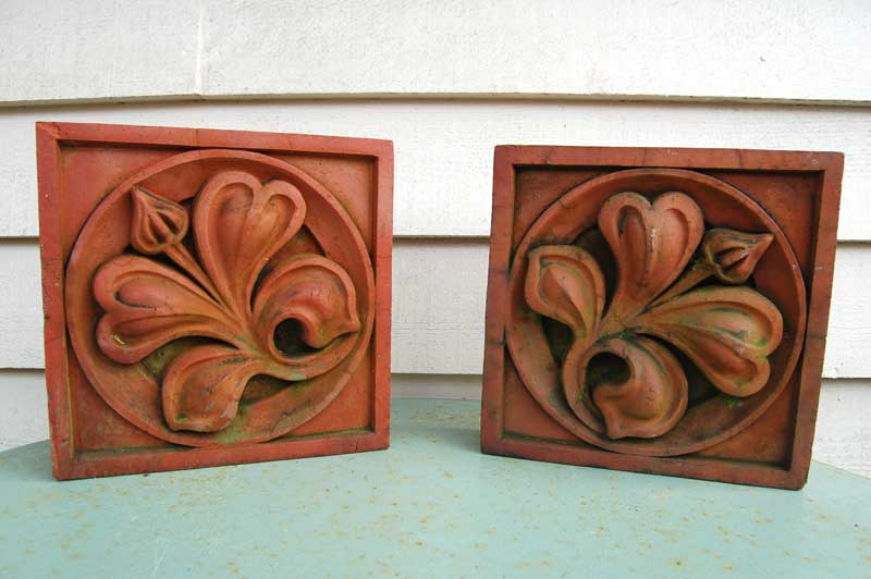 Pair of 19th Century Terracotta Brick Inserts with flower relief. £95.00. Buy online or visit Debden Barns Antiques Saffron Walden, Essex